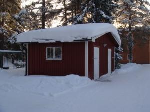 Vinterbild av soprummet i området
